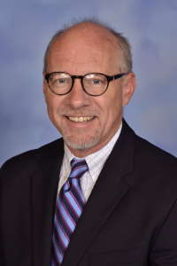 what does an interim head of school do